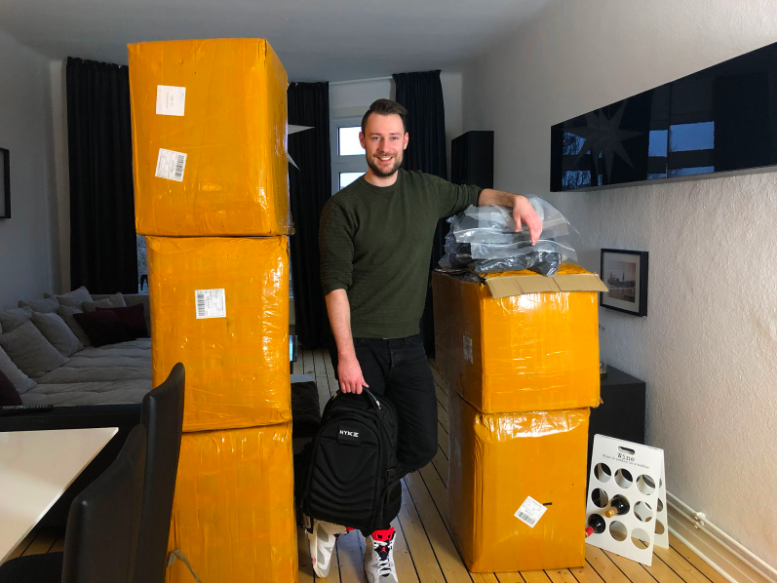 Picture showing Tim Kock and his bagpacks in boxes