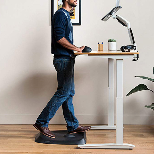Picture showing a man using a standing desk