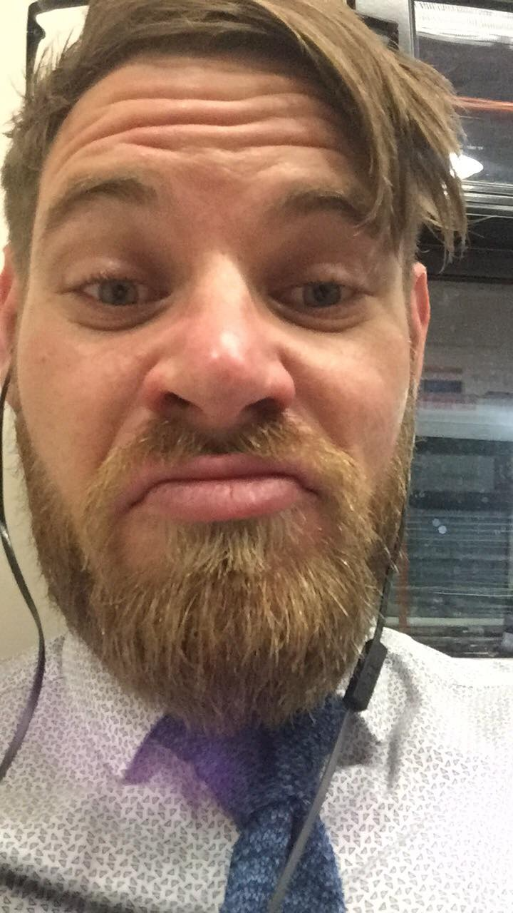 Photo of a guy taking a selfie while doing a funny face
