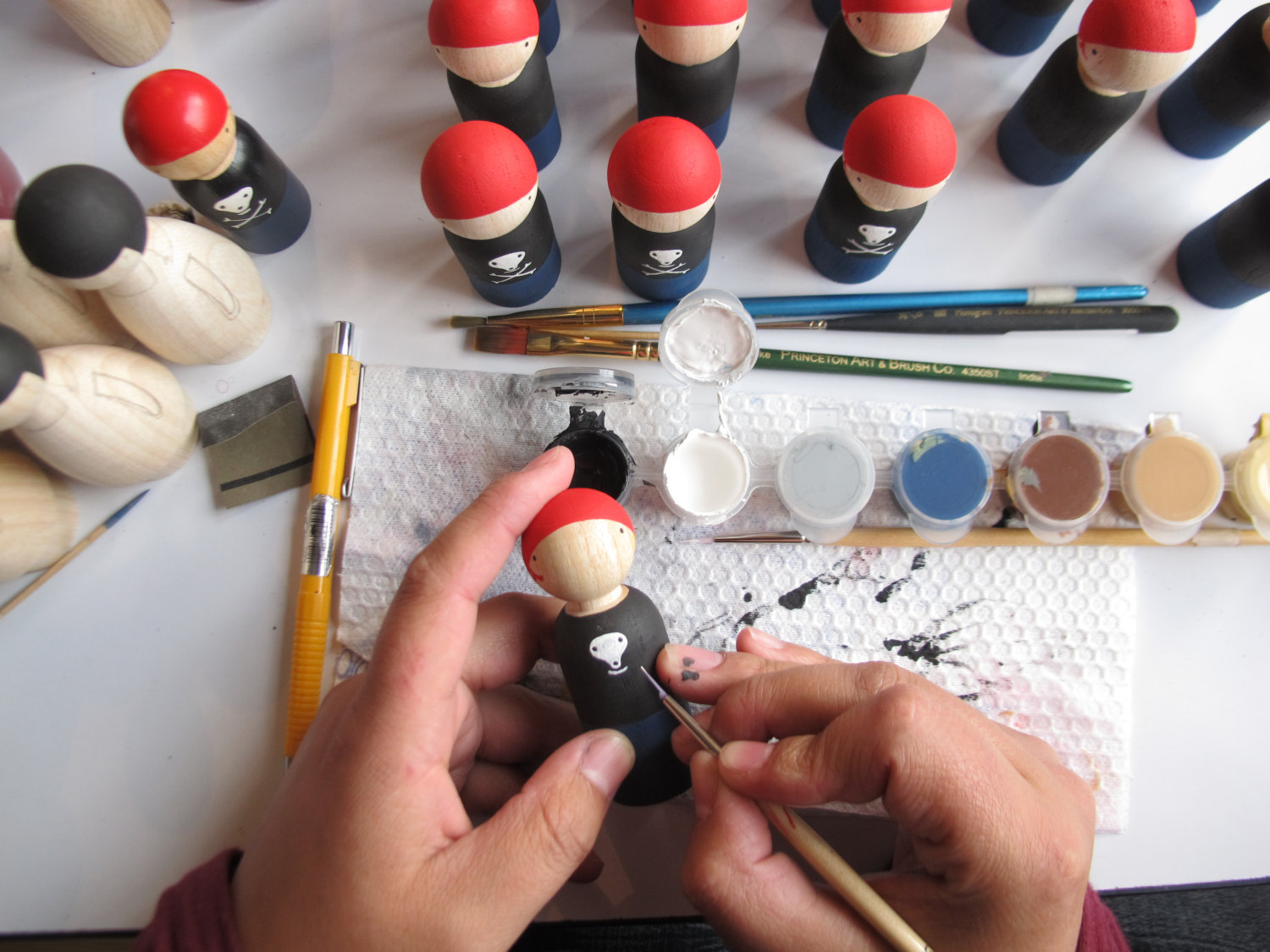 Picture of a person painting a little toy